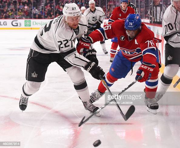 K Subban of the Montreal Canadiens fights for the puck against Trevor Lewis of the Los Angeles Kings in the NHL game at the Bell Centre on December...