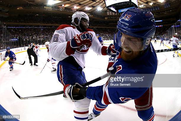 K Subban of the Montreal Canadiens gets tangled up with Brad Richards of the New York Rangers along the boards during Game Six of the Eastern...