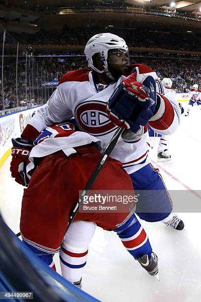 K Subban of the Montreal Canadiens gets tangled up with Martin St Louis of the New York Rangers along the boards during Game Six of the Eastern...