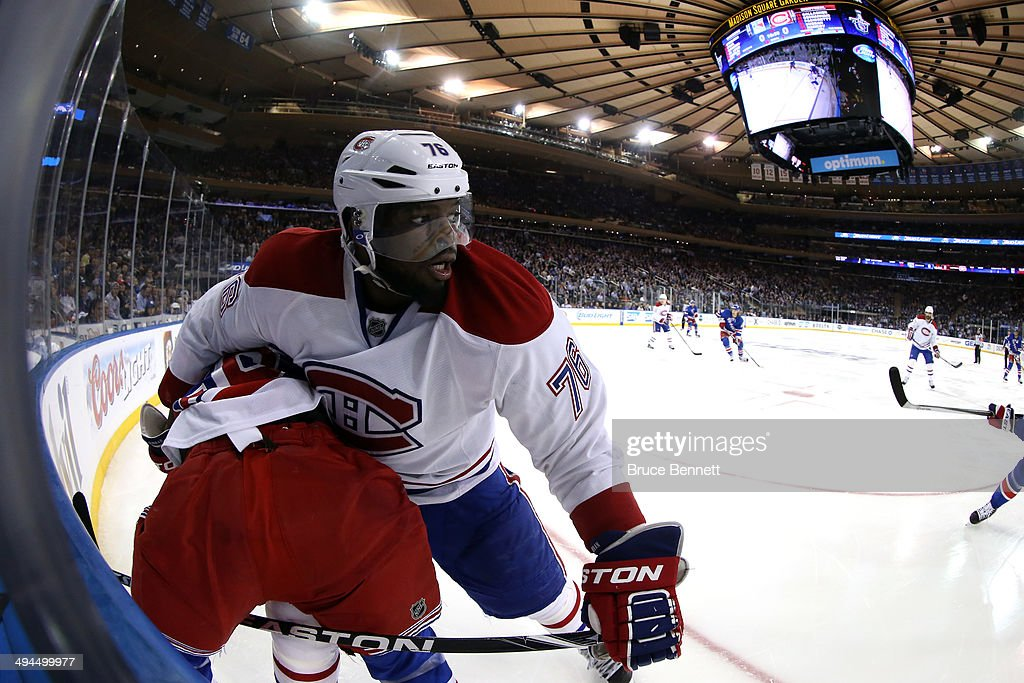 <a gi-track='captionPersonalityLinkClicked' href=/galleries/search?phrase=P.K.+Subban&family=editorial&specificpeople=714418 ng-click='$event.stopPropagation()'>P.K. Subban</a> #76 of the Montreal Canadiens gets tangled up with <a gi-track='captionPersonalityLinkClicked' href=/galleries/search?phrase=Martin+St.+Louis&family=editorial&specificpeople=202067 ng-click='$event.stopPropagation()'>Martin St. Louis</a> #26 of the New York Rangers along the boards during Game Six of the Eastern Conference Final in the 2014 NHL Stanley Cup Playoffs at Madison Square Garden on May 29, 2014 in New York City.