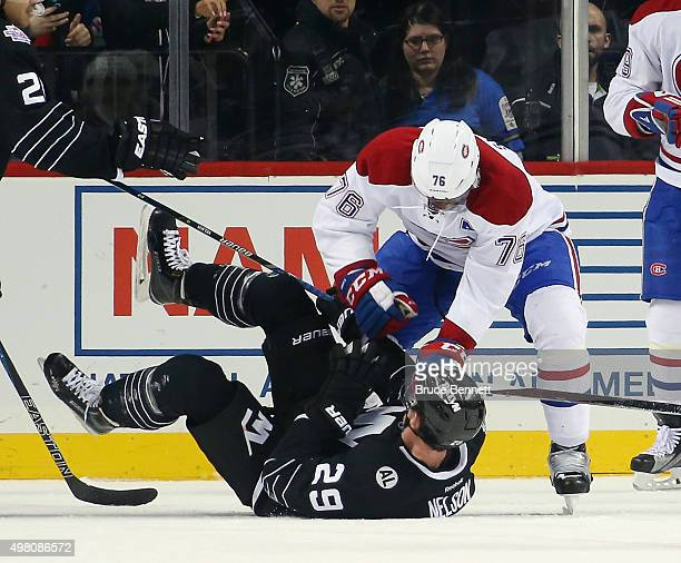 K Subban of the Montreal Canadiens hits Brock Nelson of the New York Islanders following a collision with Carey Price at the Barclays Center on...