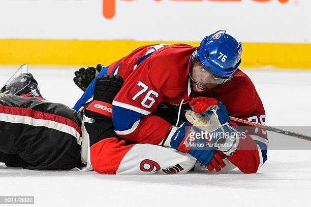 K Subban of the Montreal Canadiens holds down Bobby Ryan of the Ottawa Senators during the NHL game at the Bell Centre on December 12 2015 in...