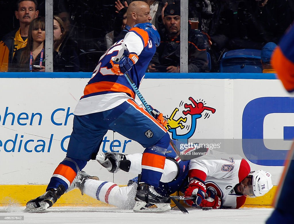 <a gi-track='captionPersonalityLinkClicked' href=/galleries/search?phrase=P.K.+Subban&family=editorial&specificpeople=714418 ng-click='$event.stopPropagation()'>P.K. Subban</a> #76 of the Montreal Canadiens is hit into the boards by <a gi-track='captionPersonalityLinkClicked' href=/galleries/search?phrase=Casey+Cizikas&family=editorial&specificpeople=4779392 ng-click='$event.stopPropagation()'>Casey Cizikas</a> #53 of the New York Islanders during the first period at the Nassau Veterans Memorial Coliseum on March 14, 2015 in Uniondale, New York.