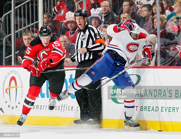 K Subban of the Montreal Canadiens is stick checked off balance by Stefan Matteau of the New Jersey Devils during the game at the Prudential Center...