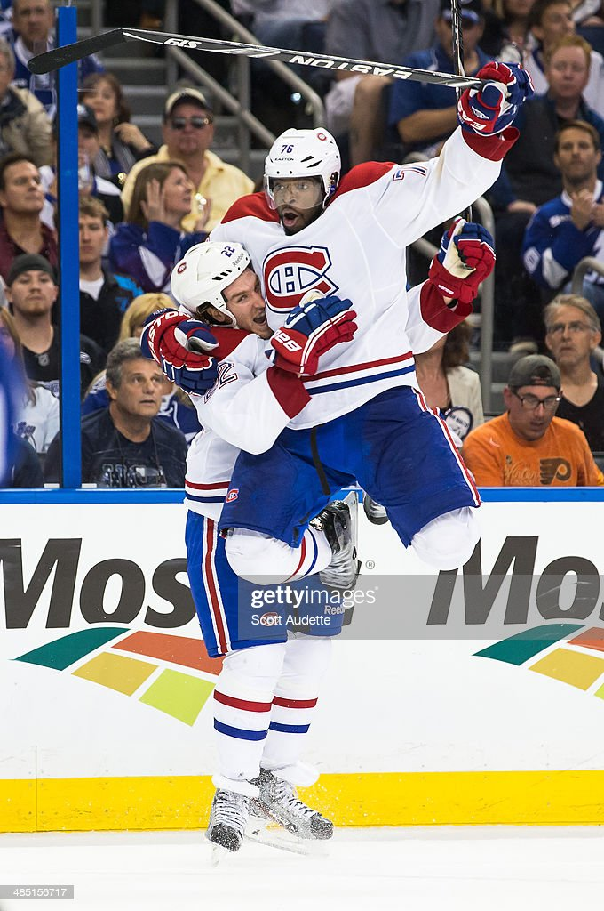 <a gi-track='captionPersonalityLinkClicked' href=/galleries/search?phrase=P.K.+Subban&family=editorial&specificpeople=714418 ng-click='$event.stopPropagation()'>P.K. Subban</a> #76 of the Montreal Canadiens jumps into the arms of <a gi-track='captionPersonalityLinkClicked' href=/galleries/search?phrase=Dale+Weise&family=editorial&specificpeople=5527418 ng-click='$event.stopPropagation()'>Dale Weise</a> #22 after Weise scored the game winning goal against the Tampa Bay Lightning in overtime in Game One of the First Round of the 2014 Stanley Cup Playoffs at the Tampa Bay Times Forum on April 16, 2014 in Tampa, Florida.