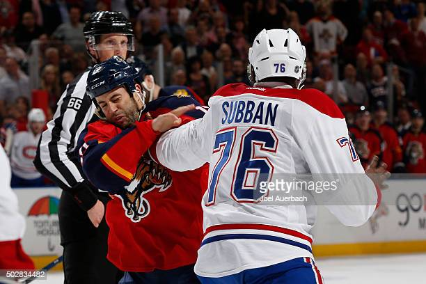 K Subban of the Montreal Canadiens lands a punch on Derek MacKenzie of the Florida Panthers during a first period fight at the BBT Center on December...
