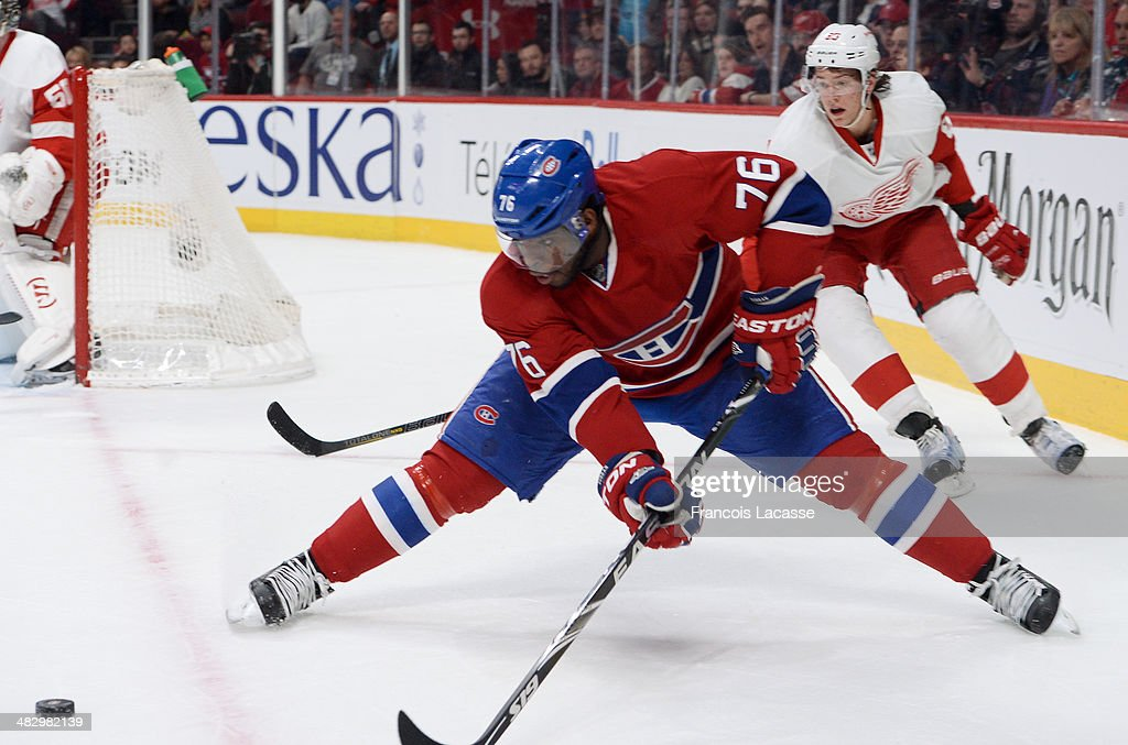 P.K. Subban #76 of the Montreal Canadiens makes a pass, followed by Danny DeKeyser #65 of the Detroit Red Wings during the NHL game on April 5, 2014 at the Bell Centre in Montreal, Quebec, Canada.
