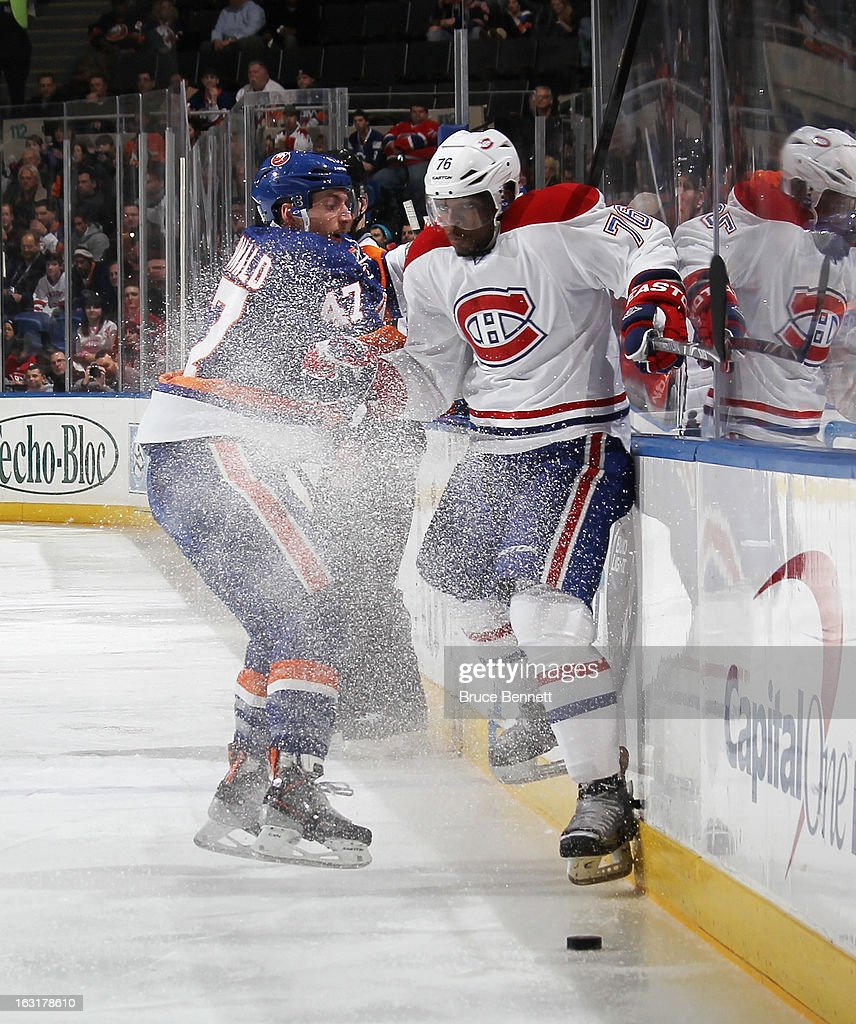 P.K. Subban #76 of the Montreal Canadiens misses a check on Andrew MacDonald #47 of the New York Islanders at the Nassau Veterans Memorial Coliseum on March 5, 2013 in Uniondale, New York. The Islanders defeated the Canadiens 6-3.