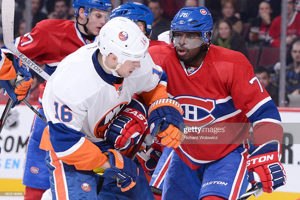 P.K. Subban #76 of the Montreal Canadiens shoves Marty Reasoner #16 of the New York Islanders during the NHL game at the Bell Centre on February 21, 2013 in Montreal, Quebec, Canada. The Islanders defeated the Canadiens 4-3 in overtime.