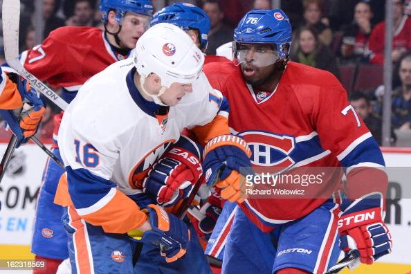K Subban of the Montreal Canadiens shoves Marty Reasoner of the New York Islanders during the NHL game at the Bell Centre on February 21 2013 in...