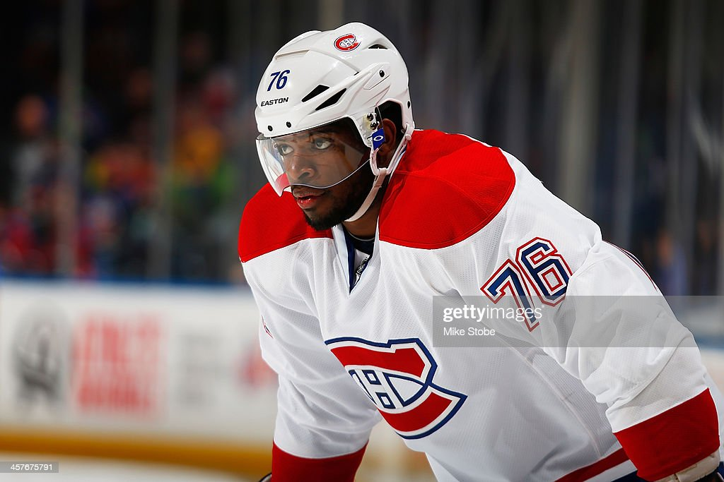 <a gi-track='captionPersonalityLinkClicked' href=/galleries/search?phrase=P.K.+Subban&family=editorial&specificpeople=714418 ng-click='$event.stopPropagation()'>P.K. Subban</a> #76 of the Montreal Canadiens skates against the New York Islanders at Nassau Veterans Memorial Coliseum on December 14, 2013 in Uniondale, New York. The Canadiens defeated the Islanders 1-0 in overtime.