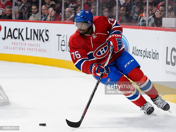 K Subban of the Montreal Canadiens skates with the puck during the NHL game against the St Louis Blues at the Bell Centre on October 20 2015 in...