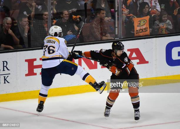 K Subban of the Nashville Predators and Brandon Montour of the Anaheim Ducks vie for position near the end boards in the third period of Game Two of...