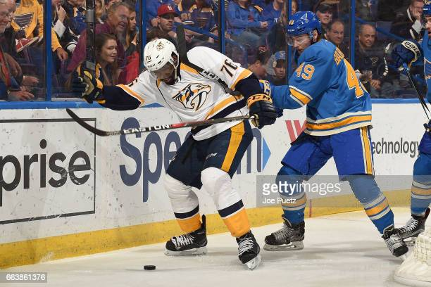 K Subban of the Nashville Predators and Ivan Barbashev of the St Louis Blues battle for control of the puck on April 2 2017 at Scottrade Center in St...