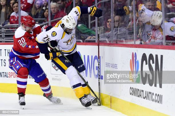 K Subban of the Nashville Predators and Lars Eller of the Washington Capitals battle for the puck in the first period during an NHL game at Verizon...