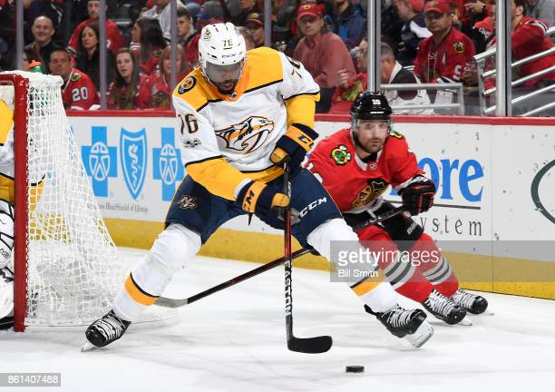 K Subban of the Nashville Predators approaches the puck ahead of Patrick Sharp of the Chicago Blackhawks in the first period at the United Center on...