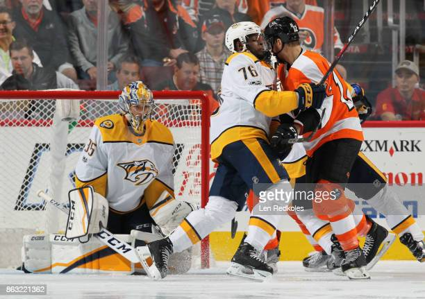 K Subban of the Nashville Predators battles for position in front of goaltender Pekka Rinne with Michael Raffl of the Philadelphia Flyers on October...