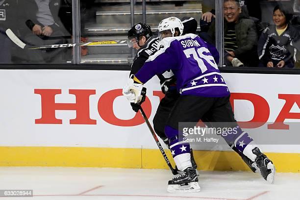 K Subban of the Nashville Predators checks Connor McDavid of the Edmonton Oilers during the 2017 Honda NHL AllStar Game Semifinal at Staples Center...