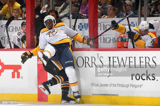 K Subban of the Nashville Predators checks Jake Guentzel of the Pittsburgh Penguins at PPG Paints Arena on October 7 2017 in Pittsburgh Pennsylvania