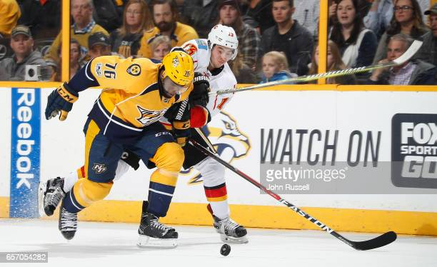 K Subban of the Nashville Predators defends against Johnny Gaudreau of the Calgary Flames during an NHL game at Bridgestone Arena on March 23 2017 in...