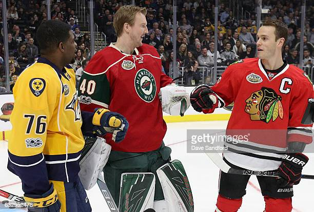PK Subban of the Nashville Predators Devan Dubnyk of the Minnesota Wild and Jonathan Toews of the Chicago Blackhawks celebrate during the 2017 Coors...
