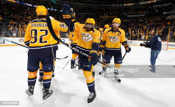 K Subban of the Nashville Predators highfives Ryan Johansen after an overtime win against the Winnipeg Jets during an NHL game at Bridgestone Arena...