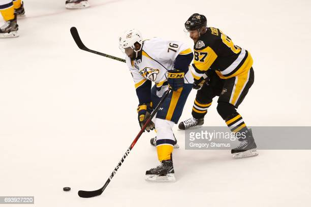 K Subban of the Nashville Predators is defended by Sidney Crosby of the Pittsburgh Penguins during the first period in Game Five of the 2017 NHL...