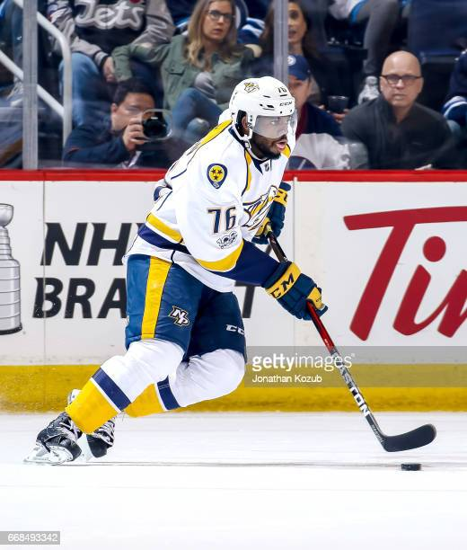 K Subban of the Nashville Predators plays the puck during first period action against the Winnipeg Jets at the MTS Centre on April 8 2017 in Winnipeg...