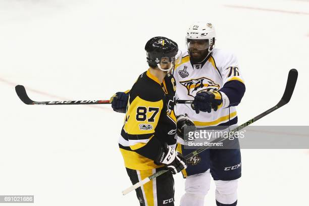 K Subban of the Nashville Predators pushes Sidney Crosby of the Pittsburgh Penguins with his stick during the second period in Game Two of the 2017...