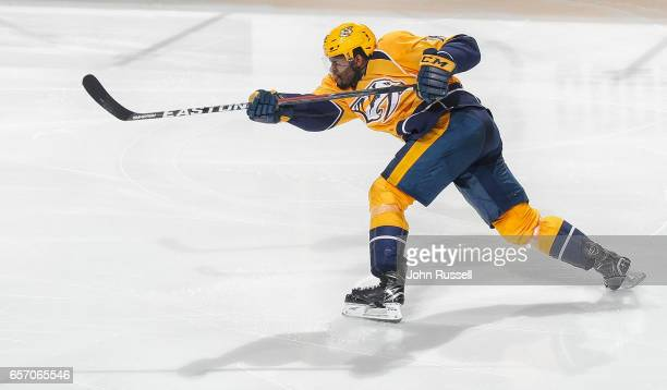 K Subban of the Nashville Predators shoots the puck against the Calgary Flames during an NHL game at Bridgestone Arena on March 23 2017 in Nashville...