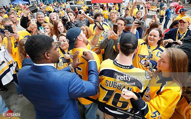 K Subban of the Nashville Predators signs for fans along the Gold Walk as players arrive for an NHL game against Chicago Blackhawks at Bridgestone...