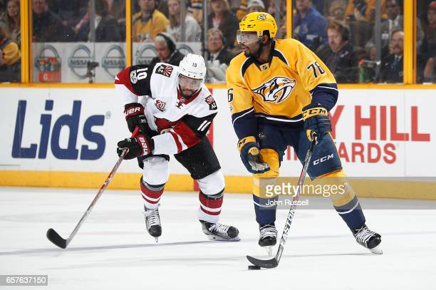 K Subban of the Nashville Predators skates against Anthony Duclair of the Arizona Coyotes during an NHL game at Bridgestone Arena on March 20 2017 in...