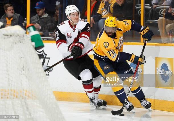K Subban of the Nashville Predators skates against Brendan Perlini of the Arizona Coyotes during an NHL game at Bridgestone Arena on March 20 2017 in...