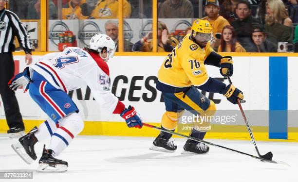 K Subban of the Nashville Predators skates against Charles Hudon of the Montreal Canadiens during an NHL game at Bridgestone Arena on November 22...