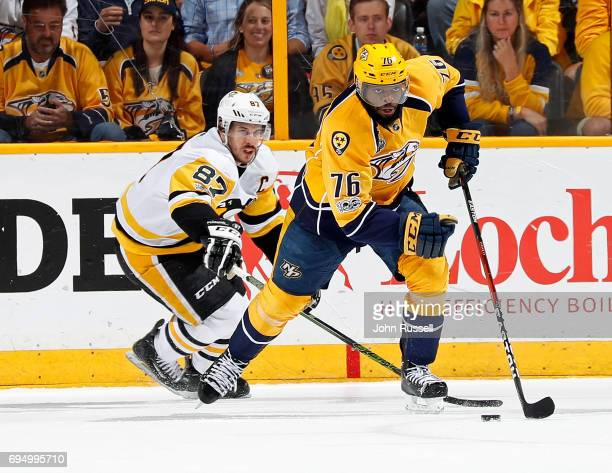 K Subban of the Nashville Predators skates the puck in front of Sidney Crosby of the Pittsburgh Penguins during Game Six of the 2017 NHL Stanley Cup...
