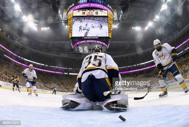 K Subban of the Nashville Predators watches as the puck gets past teammate goaltender Pekka Rinne on a shot by Justin Schultz of the Pittsburgh...