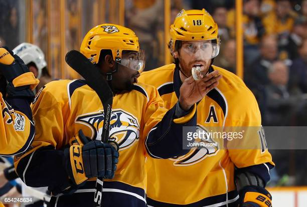 K Subban strategizes with James Neal of the Nashville Predators against the Winnipeg Jets during an NHL game at Bridgestone Arena on March 13 2017 in...