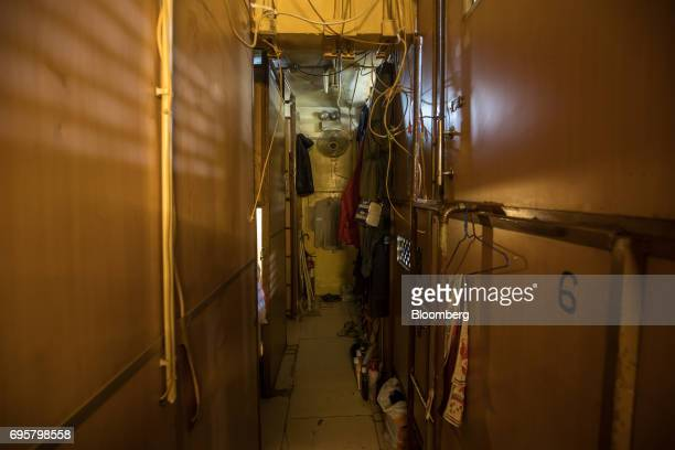 Subdivided residential units known as 'coffin homes' line a a corridor inside a building in Hong Kong China on Tuesday June 13 2017 Hong Kong a city...