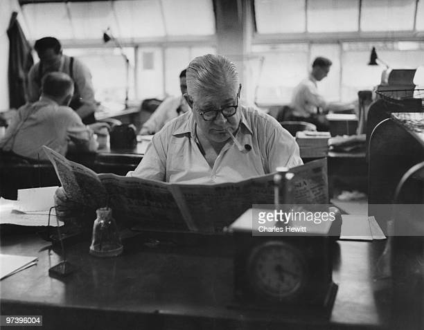 Subeditor Tom Innes in the Fetter Lane offices of the Daily Mirror newspaper London July 1953 Original publication Picture Post 6739 The Daily Mirror...