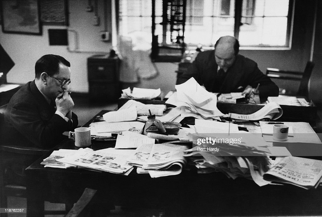 Sub-editors at work on a Saturday afternoon in the newsroom at the offices of the News of The World, April 1953. Original Publication : Picture Post - 6488 - The News of The World - pub. 18th April 1953.