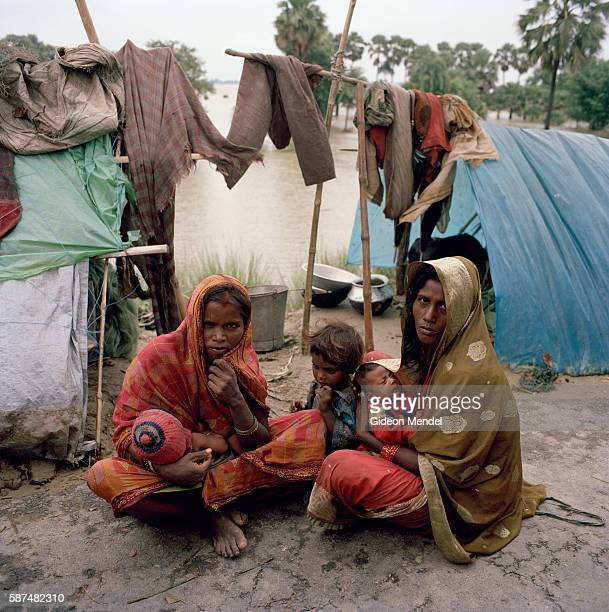 Subhagi Devi and her neighbour Sitali Devi in front of their makeshift plastic shelters set up on a road embankment in east Champaran They had to...