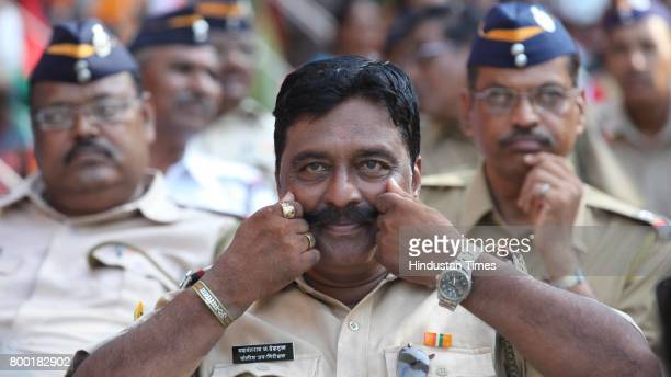 Subinspector Yeshwantrao Deshmukh poses for the camera at a function hosted by the state government for the 232 policemen who retired from the force...