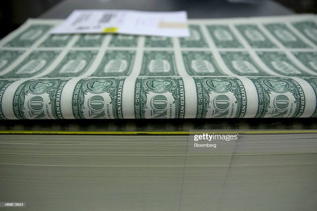 50 subject one dollar note sheets sit in a stack before receiving a serial number and the US Treasury and US Federal Reserve seals at the US Bureau...