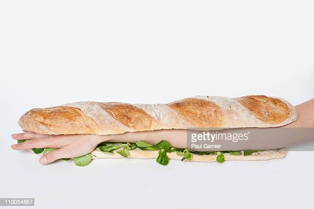 A submarine sandwich with a human arm in it