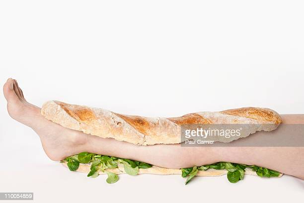A submarine sandwich with a human leg in it