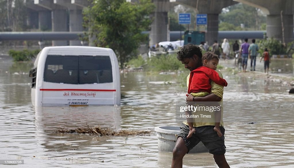 Submerged bus standing on road near Yamuna Bank metro station during flood in river Yamuna on June 20, 2013 in New Delhi, India. Low-lying areas along the Yamuna remained submerged for the second consecutive day though the water level in the river started receding today.
