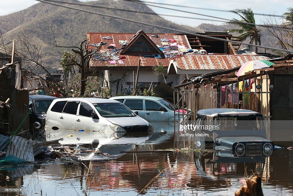 Submerged cars sit in flood waters in the aftermath of Typhoon Haiyan on November 10, 2013 in Tacloban, Leyte, Philippines. Typhoon Haiyan, packing maximum sustained winds of 195 mph (315 kph), slammed into the southern Philippines and left a trail of destruction in multiple provinces, forcing hundreds of thousands to evacuate and making travel by air and land to hard-hit provinces difficult. Around 10,000 people are feared dead in the strongest typhoon to hit the Philippines this year.