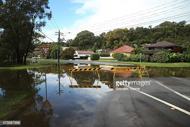 A submerged road is closed next to Narrabeen Lake on April 22 2015 in Sydney Australia Three people have died and more than 200000 are still without...