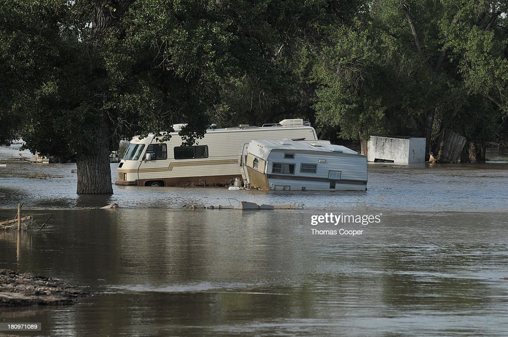 Water slowly receeds around submurged rv's near the town of Evans in Eastern, Colorado. Photo by Thomas Cooper/Getty Images. EVANS, CO - SEPTEMBER 17: Submerged RVs remain submerged in flood waters September 17, 2013 near Evans, Colorado. Even as flooding subsides, many in the hardest hit areas of the state remain stranded by washed out roads and rushing creeks and without water and power.