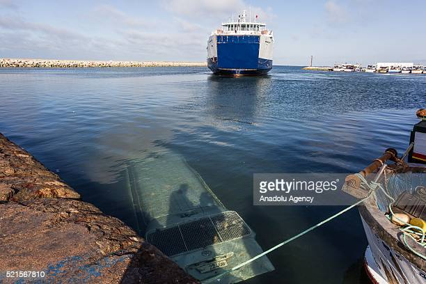 A submerged wehicle is seen after the clashes between a group of demonstrators protesting against oil tankers try to reach Petrofac Oil company's...